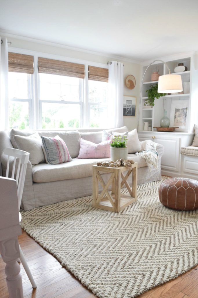 Jute rug review in our living room nesting with grace for Living room rug ideas