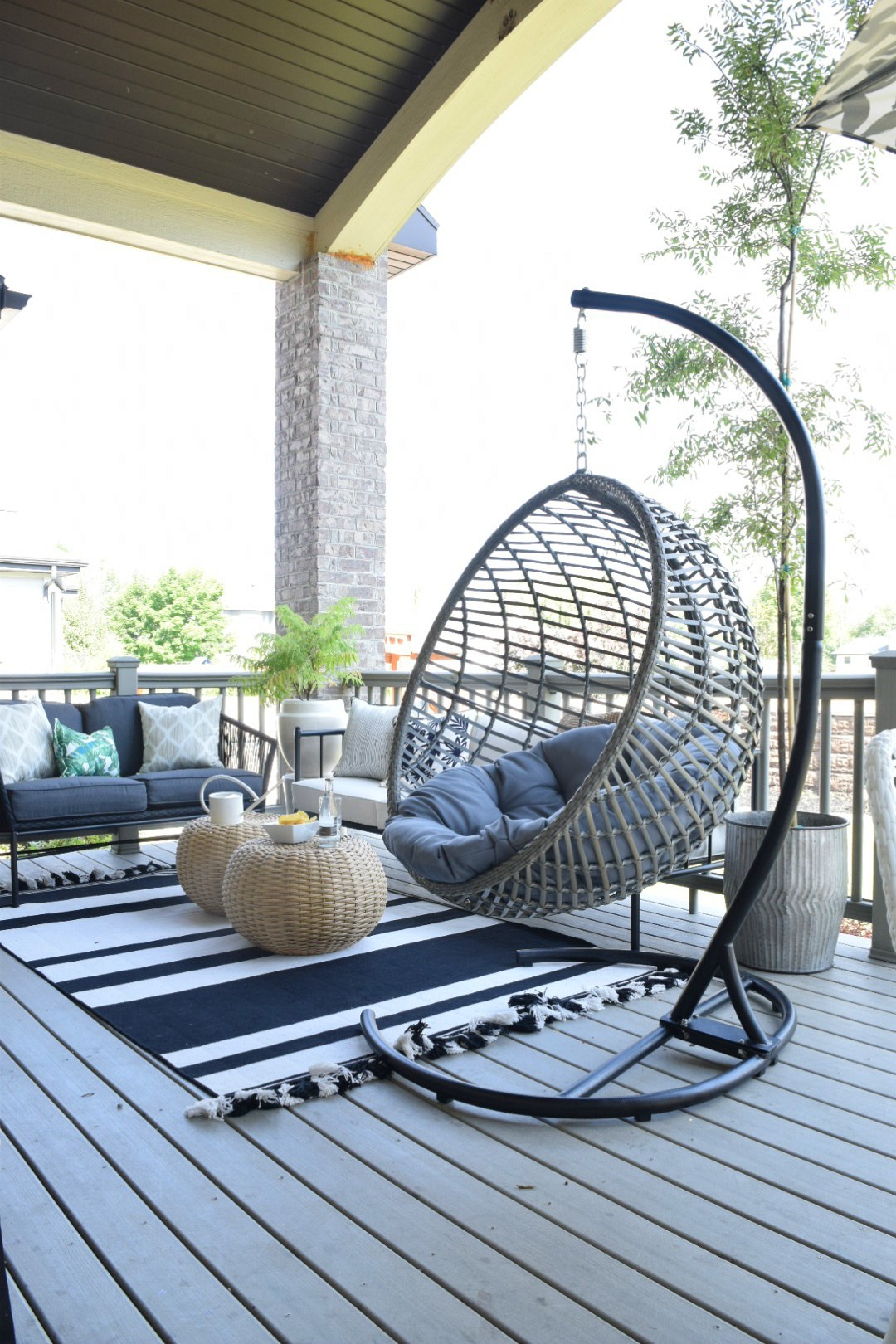 Outdoor patio and living space with hanging chair for Outdoor patio space ideas