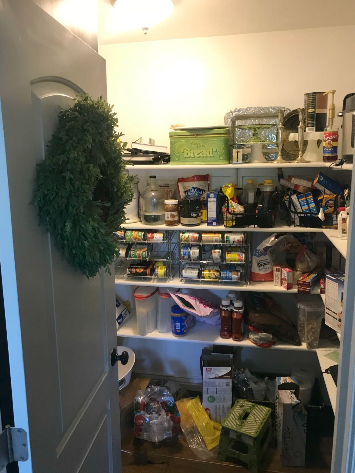 BEFORE- Pantry Organization with Wallpaper Shelves
