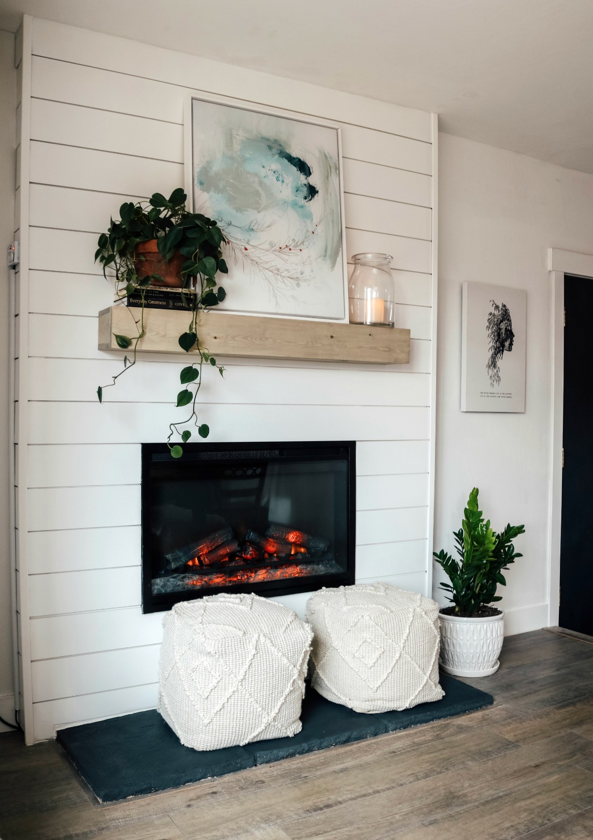 Dated Rock Fireplace turned Electric Shiplap Fireplace Makeover
