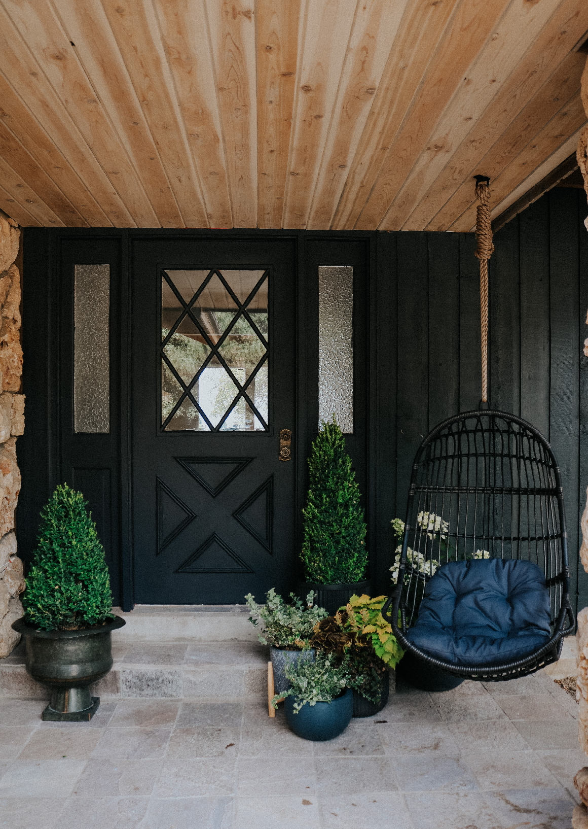 Front Porch with Hanging Chair- cedar wood ceiling hanging chair outdoors front porch decor ideas summer front porch Tricorn Black Front Door