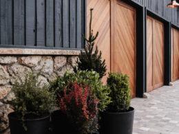 Wood Garage Doors and Copper Exterior Lights Over Doors